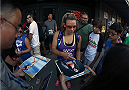 LAS VEGAS, NV - JULY 4:  Miesha Tate signs autographs for fans before the first annual Ulti-man 5K run during UFC International Fight Week at Hogs and Heifers on July 4, 2014 in Las Vegas, Nevada. Proceeds will help support Three Square Food Bank. (Photo by Brandon Magnus/Zuffa LLC/Zuffa LLC via Getty Images)