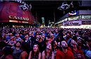 LAS VEGAS, NV - JULY 4:  A general view of fans look up and watch the clips from the UFC fights on the Viva Vision, the largest LED screen in the world, during UFC International Fight Week Free Concert Featuring Lit, P.O.D., and Papa Roach at the Fremont Street Experience Las Vegas on July 2, 2014 in Las Vegas, Nevada. (Photo by Brandon Magnus/Zuffa LLC/Zuffa LLC via Getty Images)