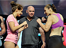 LAS VEGAS, NV - JULY 05: Mixed martial artists Sarah Moras (L) and Alexis Dufresne face off with UFC President Dana White standing between during the TUF 19 Finale weigh-in at the Mandalay Bay Convention Center on July 5, 2014 in Las Vegas, Nevada. (Photo by David Becker/Zuffa LLC/Zuffa LLC via Getty Images)