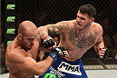 LAS VEGAS, NV - JULY 05:  (R-L) Chris Camozzi punches Bruno Santos in their middleweight fight at UFC 175 inside the Mandalay Bay Events Center on July 5, 2014 in Las Vegas, Nevada.  (Photo by Donald Miralle/Zuffa LLC/Zuffa LLC via Getty Images)