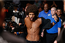 LAS VEGAS, NV - JULY 05:  Alex Caceres enters the Octagon before his fight with Urijah Faber in their bantamweight fight at UFC 175 inside the Mandalay Bay Events Center on July 5, 2014 in Las Vegas, Nevada.  (Photo by Josh Hedges/Zuffa LLC/Zuffa LLC via Getty Images)