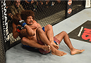 LAS VEGAS, NV - JULY 05: Urijah Faber (bottom) submits Alex Caceres with a rear naked choke in their bantamweight fight at UFC 175 inside the Mandalay Bay Events Center on July 5, 2014 in Las Vegas, Nevada. (Photo by Donald Miralle/Zuffa LLC/Zuffa LLC via Getty Images)