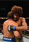 LAS VEGAS, NV - JULY 05: (R-L) Alex Caceres congratulates Urijah Faber after their bantamweight fight at UFC 175 inside the Mandalay Bay Events Center on July 5, 2014 in Las Vegas, Nevada. (Photo by Donald Miralle/Zuffa LLC/Zuffa LLC via Getty Images)