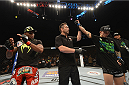 LAS VEGAS, NV - JULY 05: (R-L) Russell Doane celebrates his victory over Marcus Brimage in their bantamweight fight at UFC 175 inside the Mandalay Bay Events Center on July 5, 2014 in Las Vegas, Nevada. (Photo by Donald Miralle/Zuffa LLC/Zuffa LLC via Getty Images)