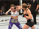 LAS VEGAS, NV - JULY 05:  (R-L) UFC bantamweight Champion Ronda Rousey punches Alexis Davis in their UFC women's bantamweight championship fight at UFC 175 inside the Mandalay Bay Events Center on July 5, 2014 in Las Vegas, Nevada.  (Photo by Donald Miralle/Zuffa LLC/Zuffa LLC via Getty Images)