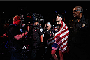 LAS VEGAS, NV - JULY 05:  UFC middleweight champion Chris Weidman celebrates defeating Lyoto Machida in their UFC middleweight championship fight at UFC 175 inside the Mandalay Bay Events Center on July 5, 2014 in Las Vegas, Nevada.  (Photo by Josh Hedges/Zuffa LLC/Zuffa LLC via Getty Images)