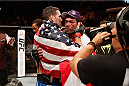 LAS VEGAS, NV - JULY 05:  (L-R) UFC middleweight champion Chris Weidman hugs Lyoto Machida after defeating him in their UFC middleweight championship fight at UFC 175 inside the Mandalay Bay Events Center on July 5, 2014 in Las Vegas, Nevada.  (Photo by Josh Hedges/Zuffa LLC/Zuffa LLC via Getty Images)