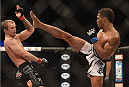 LAS VEGAS, NV - JULY 06:  (R-L) Kevin Lee kicks Jesse Ronson in their flyweight fight during the Ultimate Fighter Finale inside the Mandalay Bay Events Center on July 6, 2014 in Las Vegas, Nevada.  (Photo by Jeff Bottari/Zuffa LLC/Zuffa LLC via Getty Images)
