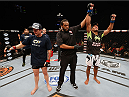LAS VEGAS, NV - JULY 06:  (R-L) Kevin Lee celebrates after defeating Jesse Ronson in their flyweight fight during the Ultimate Fighter Finale inside the Mandalay Bay Events Center on July 6, 2014 in Las Vegas, Nevada.  (Photo by Josh Hedges/Zuffa LLC/Zuffa LLC via Getty Images)