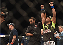 LAS VEGAS, NV - JULY 06:  (R-L) Kevin Lee celebrates after defeating Jesse Ronson in their flyweight fight during the Ultimate Fighter Finale inside the Mandalay Bay Events Center on July 6, 2014 in Las Vegas, Nevada.  (Photo by Jeff Bottari/Zuffa LLC/Zuffa LLC via Getty Images)