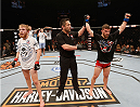 LAS VEGAS, NV - JULY 06:  (R-L) Dustin Scoggins celebrates defeating Justin Scoggins by decision in their flyweight fight during the Ultimate Fighter Finale inside the Mandalay Bay Events Center on July 6, 2014 in Las Vegas, Nevada.  (Photo by Josh Hedges/Zuffa LLC/Zuffa LLC via Getty Images)