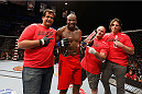 LAS VEGAS, NV - JULY 06:  Eddie Gordon celebrates with his coaches after defeating Dhiego Lima in their middleweight fight during the Ultimate Fighter Finale inside the Mandalay Bay Events Center on July 6, 2014 in Las Vegas, Nevada.  (Photo by Josh Hedges/Zuffa LLC/Zuffa LLC via Getty Images)