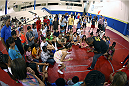 LAS VEGAS, NV - JULY 1:  UFC Fighter Daniel Cormier shows some wrestling moves to the kids as the UFC, Ultimate Alliance and Boys & Girls Club of Las Vegas announce a partnership to host after school wrestling programs to kick off the UFC International Fight Week at the Boys & Girls Club of Southern Nevada on July 1, 2014 in Las Vegas, Nevada. (Photo by Brandon Magnus/Zuffa LLC/Zuffa LLC via Getty Images)