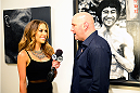 LAS VEGAS, NV - JULY 1:  (L-R) UFC Octagon Girl and artist Brittney Palmer interviews UFC President Dana White at the Art of Fighting Exhibition to kick off the UFC International Fight Week at The Gallery on 1217 on July 1, 2014 in Las Vegas, Nevada. (Photo by Jeff Bottari/Zuffa LLC/Zuffa LLC via Getty Images)