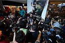 LAS VEGAS, NV - JULY 02:  UFC middleweight champion Chris Weidman interacts with media after an open training session ahead of UFC 175 at the Fashion Show Mall on July 2, 2014 in Las Vegas, Nevada.  (Photo by Josh Hedges/Zuffa LLC/Zuffa LLC via Getty Images)