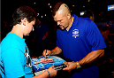 LAS VEGAS, NV - JULY 2: Chuck Liddell signs an autograph for a fan during the UFC International Fight Week charity bowling event at Brooklyn Bowl Las Vegas at The LINQ on July 2, 2014 in Las Vegas, Nevada. (Photo by Brandon Magnus/Zuffa LLC/Zuffa LLC via Getty Images)