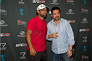 LAS VEGAS, NV - JULY 2:  UFC welterweight champion Johny Hendricks (L) poses with a guest at the UFC LINQ High Roller charity auction takeover during UFC International Fight Week at The Las Vegas High Roller at The LINQ on July 2, 2014 in Las Vegas, Nevada. (Photo by Al Powers/Zuffa LLC/Zuffa LLC via Getty Images)