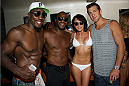 LAS VEGAS, NV - JULY 3:  (L-R) Mixed martial artists Phil Davis, Rashad Evans, UFC Octagon Girl Rachelle Leah and Luke Rockhold pose at the UFC pool party during UFC International Fight Week at the Liquid Pool Lounge at the Aria Resort & Casino at CityCenter on July 3, 2014 in Las Vegas, Nevada. (Photo by Al Powers/Zuffa LLC/Zuffa LLC via Getty Images) *** Local Caption *** Phil Davis;Rashad Evans;Rachelle Leah;Luke Rockhold