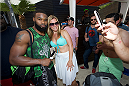 LAS VEGAS, NV - JULY 3:  UFC welterweight fighter Tyron Woodley (L) poses with a fan at the UFC pool party during UFC International Fight Week at the Liquid Pool Lounge at the Aria Resort & Casino at CityCenter on July 3, 2014 in Las Vegas, Nevada. (Photo by Al Powers/Zuffa LLC/Zuffa LLC via Getty Images) *** Local Caption *** Tyron Woodley
