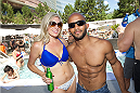 LAS VEGAS, NV - JULY 3:  UFC flyweight champion Demetrious 'Mighty Mouse' Johnson (R) poses with his wife Destiny at the UFC pool party during UFC International Fight Week at the Liquid Pool Lounge at the Aria Resort & Casino at CityCenter on July 3, 2014 in Las Vegas, Nevada. (Photo by Al Powers/Zuffa LLC/Zuffa LLC via Getty Images) *** Local Caption *** Demetrious Johnson;Destiny Johnson