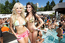 LAS VEGAS, NV - JULY 3:  UFC Octagon Girls Jhenny Andrade (L) and Camila Rodrigues de Oliveira pose at the UFC pool party during UFC International Fight Week at the Liquid Pool Lounge at the Aria Resort & Casino at CityCenter on July 3, 2014 in Las Vegas, Nevada. (Photo by Al Powers/Zuffa LLC/Zuffa LLC via Getty Images) *** Local Caption *** Jhenny Andrade;Camila Oliveira