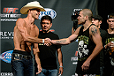 "ATLANTIC CITY, NJ - JULY 15:  Donald ""Cowboy"" Cerrone (L) and Jim Miller shake hands after facing off during the UFC Fight Night weigh-in at Revel Casino on July 15, 2014 in Atlantic City, New Jersey.  (Photo by Jeff Bottari/Zuffa LLC/Zuffa LLC via Getty Images)"