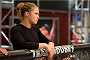 LAS VEGAS, NV - JUNE 21:  Coach Ronda Rousey stands above Peggy Morgan's (not pictured) corner before her preliminary fight against Sarah Moras (not pictured) during filming of season eighteen of The Ultimate Fighter on June 21, 2013 in Las Vegas, Nevada. (Photo by Josh Hedges/Zuffa LLC/Zuffa LLC via Getty Images) *** Local Caption *** Ronda Rousey