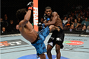 ATLANTIC CITY, NJ - JULY 16: (L-R) Hugo Viana kicks Aljamain Sterling in their bantamweight bout during the UFC Fight Night event at Revel Casino on July 16, 2014 in Atlantic City, New Jersey. (Photo by Jeff Bottari/Zuffa LLC/Zuffa LLC via Getty Images)