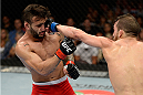 ATLANTIC CITY, NJ - JULY 16: (R-L) Alptekin Ozkilic punches John Lineker in their flyweight bout during the UFC Fight Night event at Revel Casino on July 16, 2014 in Atlantic City, New Jersey. (Photo by Jeff Bottari/Zuffa LLC/Zuffa LLC via Getty Images)