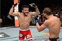 ATLANTIC CITY, NJ - JULY 16: (L-R) John Lineker taunts at Alptekin Ozkilic in their flyweight bout during the UFC Fight Night event at Revel Casino on July 16, 2014 in Atlantic City, New Jersey. (Photo by Jeff Bottari/Zuffa LLC/Zuffa LLC via Getty Images)
