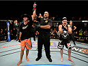 "ATLANTIC CITY, NJ - JULY 16: (L-R) Donald ""Cowboy"" Cerrone celebrates after defeating Jim Miller in their lightweight bout during the UFC Fight Night event at Revel Casino on July 16, 2014 in Atlantic City, New Jersey. (Photo by Jeff Bottari/Zuffa LLC/Zuffa LLC via Getty Images)"