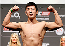 DUBLIN, IRELAND - JULY 18:  Naoyuki Kotani poses on the scale after weighing in during the UFC weigh-in event at The O2 on July 18, 2014 in Dublin, Ireland.  (Photo by Josh Hedges/Zuffa LLC/Zuffa LLC via Getty Images)