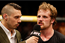 DUBLIN, IRELAND - JULY 19:  (R-L) Gunnar Nelson is interviewed by Dan Hardy after his submission victory over Zak Cummings in their welterweight bout during the UFC Fight Night event at The O2 Dublin on July 19, 2014 in Dublin, Ireland.  (Photo by Josh Hedges/Zuffa LLC/Zuffa LLC via Getty Images)