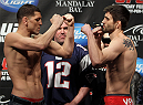 LAS VEGAS, NV - FEBRUARY 03:  (L-R) Welterweight opponents Nick Diaz and Carlos Condit face off after weighing in during the UFC 143 official weigh in at Mandalay Bay Events Center on February 3, 2012 in Las Vegas, Nevada.|2:55:8  (Photo by Josh Hedges/Zuffa LLC/Zuffa LLC via Getty Images) *** Local Caption *** Nick Diaz; Carlos Condit