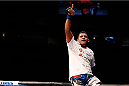SAN JOSE, CA - JULY 26:  Gilbert Burns celebrates after defeating Andreas Stahl in their welterweight bout during the UFC Fight Night event at SAP Center on July 26, 2014 in San Jose, California.  (Photo by Josh Hedges/Zuffa LLC/Zuffa LLC via Getty Images)