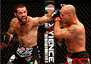 SAN JOSE, CA - JULY 26:  (L-R) Matt Brown punches Robbie Lawler in their welterweight bout during the UFC Fight Night event at SAP Center on July 26, 2014 in San Jose, California.  (Photo by Josh Hedges/Zuffa LLC/Zuffa LLC via Getty Images)