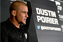 LAS VEGAS, NV - AUGUST 4:  Dustin Poirier interacts with the media during the UFC 178 Ultimate Media Day at the MGM Grand Hotel/Casino on August 4, 2014 in Las Vegas, Nevada. (Photo by Jeff Bottari/Zuffa LLC/Zuffa LLC via Getty Images)