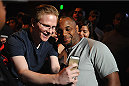 LOS ANGELES, CA - AUGUST 05:  Mixed martial artist Daniel Cormier poses with a fan after a UFC Q&A at LA Live on August 5, 2014 in Los Angeles, California.  (Photo by Jonathan Moore/Zuffa LLC/Zuffa LLC via Getty Images)