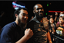 LOS ANGELES, CA - AUGUST 05:   Mixed martial artist Jon Jones poses with a fan after a UFC Q&A at LA Live on August 5, 2014 in Los Angeles, California.  (Photo by Jonathan Moore/Zuffa LLC/Zuffa LLC via Getty Images)