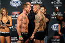 BANGOR, ME - AUG 15:  (L-R) Gray Maynard and Ross Pearson face off during the UFC fight night weigh-in at the Cross Insurance Center on August 15, 2014 in Bangor, Maine. (Photo by Jeff Bottari/Zuffa LLC/Zuffa LLC via Getty Images)