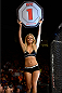 BANGOR, ME - AUGUST 16:  UFC Octagon Girl Chrissy Blair signals the start of round one between Sara McMann and Lauren Murphy during the UFC fight night event at the Cross Insurance Center on August 16, 2014 in Bangor, Maine. (Photo by Jeff Bottari/Zuffa LLC/Zuffa LLC via Getty Images)