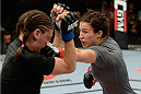 BANGOR, ME - AUGUST 16:  (R-L) Sara McMann punches Lauren Murphy in their women's bantamweight bout during the UFC fight night event at the Cross Insurance Center on August 16, 2014 in Bangor, Maine. (Photo by Jeff Bottari/Zuffa LLC/Zuffa LLC via Getty Images)