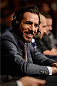 BANGOR, ME - AUGUST 16:  UFC announcer Kenny Florian calls the fight between Thiago Tavares and Robbie Peralta in their featherweight bout during the UFC fight night event at the Cross Insurance Center on August 16, 2014 in Bangor, Maine. (Photo by Jeff Bottari/Zuffa LLC/Zuffa LLC via Getty Images)