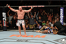 BANGOR, ME - AUGUST 16:  (L-R) Tim Boetsch celebrates after knocking out Brad Tavares in their middleweight bout during the UFC fight night event at the Cross Insurance Center on August 16, 2014 in Bangor, Maine. (Photo by Jeff Bottari/Zuffa LLC/Zuffa LLC via Getty Images)