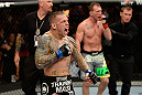 BANGOR, ME - AUGUST 16:  (L-R) Ross Pearson celebrates after knocking out Gray Maynard in their lightweight bout during the UFC fight night event at the Cross Insurance Center on August 16, 2014 in Bangor, Maine. (Photo by Jeff Bottari/Zuffa LLC/Zuffa LLC via Getty Images)