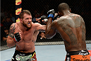 BANGOR, ME - AUGUST 16:  (L-R) Ryan Bader punches Ovince Saint Preux in their light heavyweight bout during the UFC fight night event at the Cross Insurance Center on August 16, 2014 in Bangor, Maine. (Photo by Jeff Bottari/Zuffa LLC/Zuffa LLC via Getty Images)