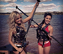 Octagon girls Jhenny Andrade and Camila Oliveira paddleboarding on Lago Paranoa.