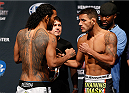 TULSA, OK - AUGUST 22: (L-R) Opponents Benson Henderson and Rafael dos Anjos of Brazil face off during the UFC Fight Night weigh-in at the BOK Center on August 22, 2014 in Tulsa, Oklahoma. (Photo by Josh Hedges/Zuffa LLC/Zuffa LLC via Getty Images)