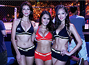 MACAU - AUGUST 23:  (L to R) Octagon girls, Rosemary Vandenbroucke, Jennifer Nguyen and Jessica Cambensy pose for a photo during the UFC Fight Night event at the Venetian Macau on August 23, 2014 in Macau. (Photo by Mitch Viquez/Zuffa LLC/Zuffa LLC via Getty Images)