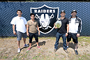 ALAMEDA, CA - AUGUST 26:  UFC lightweight Gilbert Melendez, flyweight Joseph Benavidez, bantamweight champion TJ Dillashaw and Dan Marks attend the Oakland Raiders practice at the Oakland Raiders training facility on August 26, 2014 in Alameda, California. (Photo by Jeff Bottari/Zuffa LLC/Zuffa LLC via Getty Images)